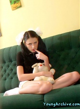 Teenie girl with pigtails in schoolgirl uniform is showing her shaved pussy - 5 anal pictures