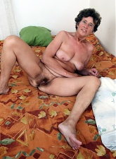 Brunette granny mom is posing nude and masturbating hairy pussy - 5 anal pictures