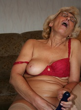 Lusty blonde grandmom is masturbating with dildo on a chair - 5 anal pictures