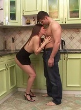 Dark haired horny girlfriend eating a large pecker in the kitchen - 4 anal movies